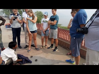 A Russian tourist family watching magic in front of jal Mahal Jaipur