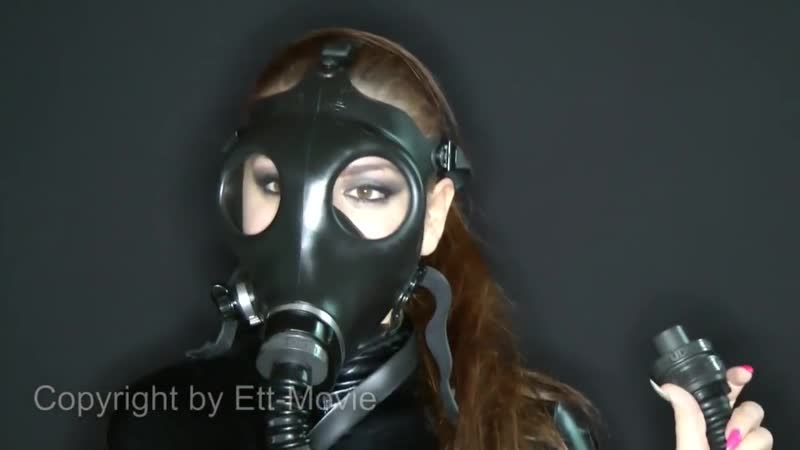 Latex catsuit girl in gasmask