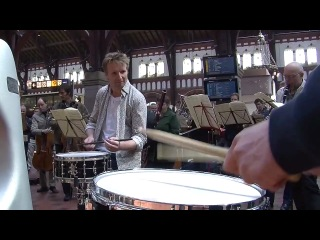 Flash mob at copenhagen central station. copenhagen phil playing ravel's bolero.