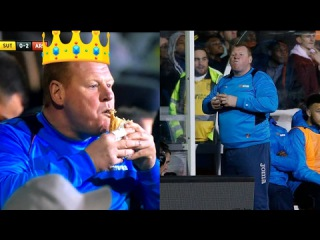 Wayne Shaw eating a pie during Sutton - Arsenal FA Cup match
