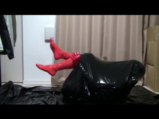 Red rubber catsuit body bag 002