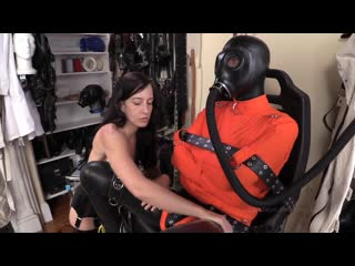 Bondage boy in gas mask