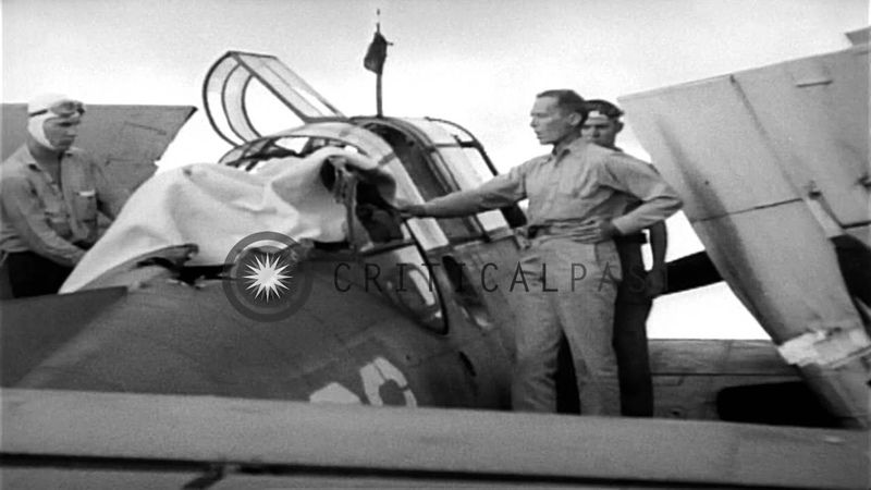 US Navy TBF Avenger gunner from USS Essex is buried at sea with his aircraft Stock Footage