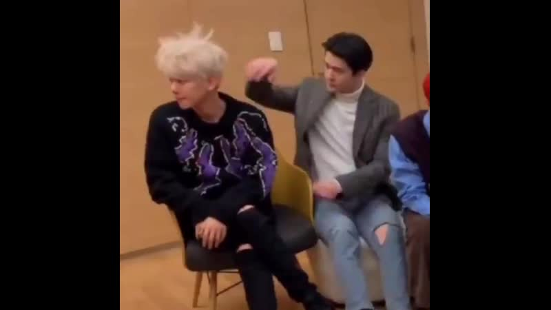 Baekhyun messing up his hair and sehun couldn't resist himself but also touch his hyung's hair