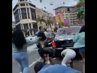 Rich The Kid made it rain on Rodeo Drive